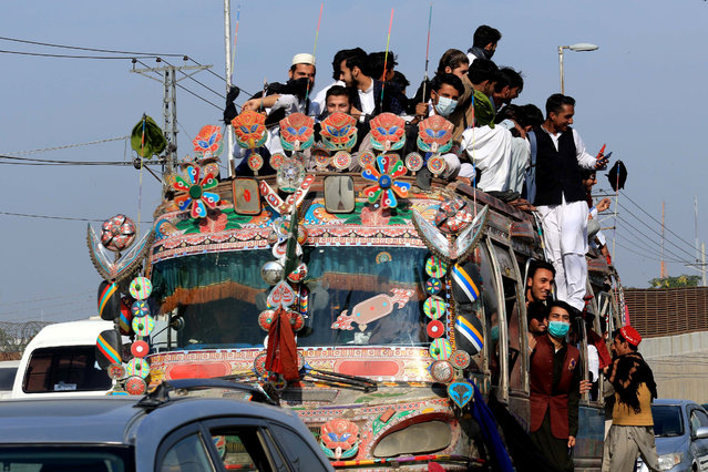 Passengers wears a face mask while riding on a bus after new cases of COVID-19 were reported in Peshawar, Pakistan, 18 November 2020. Countries around the world are taking increased measures to stem the widespread of the Covid-19 disease. (Photo by Arshad Arbab/EPA/EFE/Rex Features/Shutterstock)