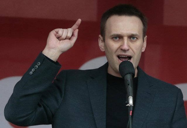Russian opposition leader Alexei Navalny speaks during a major protest rally in Bolotnaya Square in Moscow, Russia, Monday, May 6, 2013. Up to 20,000 Russian opposition supporters gathered for a protest on Monday, venting anger against the Kremlin and demanding the release of political prisoners. The protest came exactly one year after a demonstration a day before President Vladimir Putin's third presidential inauguration on the same square near the Kremlin ended in violent clashes between demonstrators and police. (AP Photo/Mikhail Metzel)