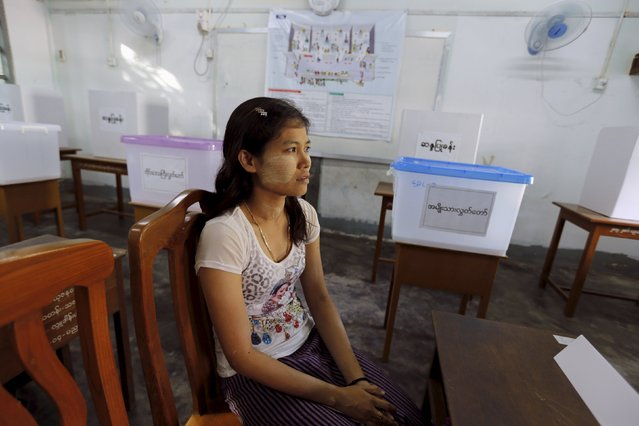 A woman sits inside a polling station during a demostration to the media about voting process before Myanmar's general elections in Yangon November 7, 2015. (Photo by Jorge Silva/Reuters)