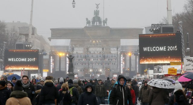 People attend New Year celebrations at the Brandenburger Tor gate in Berlin December 31, 2014. (Photo by Fabrizio Bensch/Reuters)