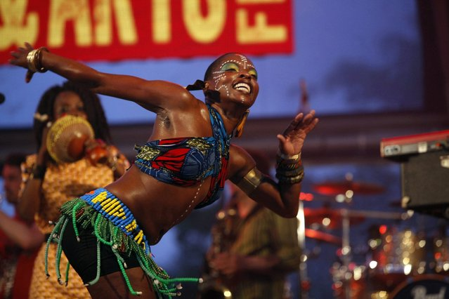 A fela dancer, accompanying Nigerian musician Tony Allen's band with its Afro-beat rhythms, performs during their set on stage at the St Lucia Jazz and Arts Festival at Pigeon Island National Landmark May 11, 2013. (Photo by Andrea De Silva/Reuters)