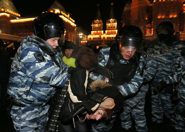 Police officers detain a supporter of opposition leader and anti-corruption blogger Alexei Navalny during a rally in central Moscow, Russia, 30 December 2014. Alexei Navalny was arrested on 30 December after showing up at an unsanctioned rally against his own sentencing earlier that day. (Photo by Yuri Kochetkov/EPA)