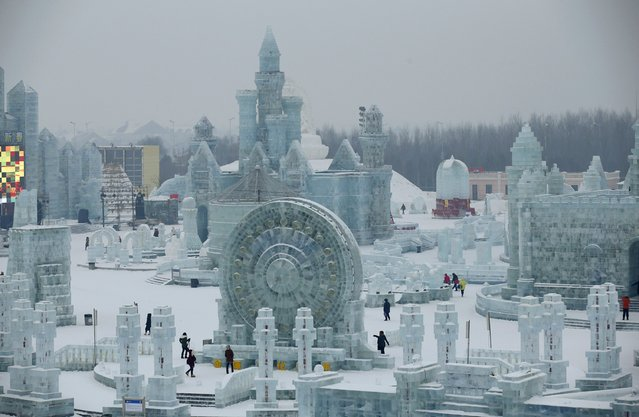 Visitors look around ice sculptures ahead of the 31st Harbin International Ice and Snow Festival in the northern city of Harbin, Heilongjiang province, January 4, 2015. (Photo by Kim Kyung-Hoon/Reuters)