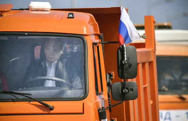 Russian President Vladimir Putin drives a Kamaz truck during a ceremony opening a bridge, which was constructed to connect the Russian mainland with the Crimean Peninsula across the Kerch Strait, May 15, 2018. (Photo by Alexander Nemenov/Reuters/Pool)