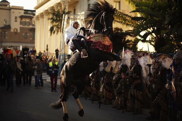 A rider rears up on his horse during the traditional Epiphany parade in Malaga, southern Spain January 5, 2015. Traditionally, children in Spain receive their presents delivered by the Three Wise Men on the morning of January 6 during the Christian holiday of the Epiphany. (Photo by Jon Nazca/Reuters)