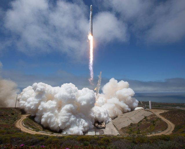 The NASA/German Research Centre for Geosciences GRACE Follow-On spacecraft launch onboard a SpaceX Falcon 9 rocket, Tuesday, May 22, 2018, from Space Launch Complex 4E at Vandenberg Air Force Base in California. The mission will measure changes in how mass is redistributed within and among Earth's atmosphere, oceans, land and ice sheets, as well as within Earth itself. GRACE-FO is sharing its ride to orbit with five Iridium NEXT communications satellites as part of a commercial rideshare agreement. (Photo by Bill Ingalls/AFP Photo/NASA)