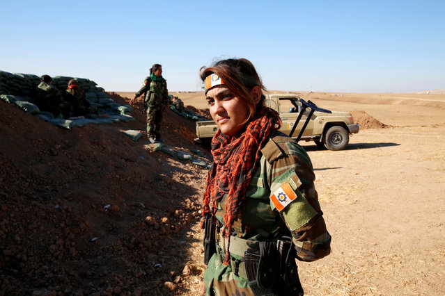 An Iranian-Kurdish female fighter is seen during a battle with Islamic State militants in Bashiqa, near Mosul, Iraq on November 3, 2016. (Photo by Ahmed Jadallah/Reuters)