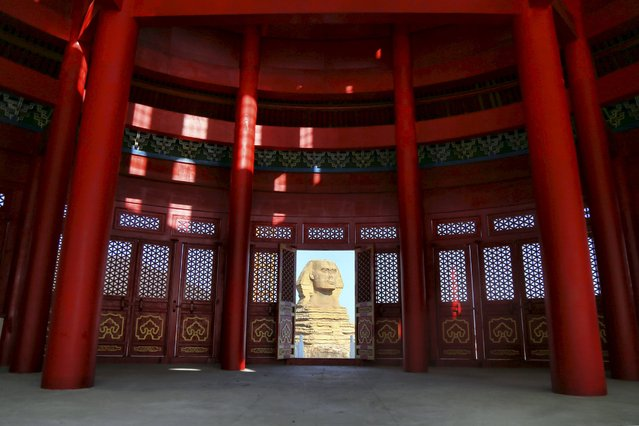 A replica of the Sphinx is seen through a door on a building, which is made by half of a replica of the Qinian Hall of the Temple of the Heaven and half of a western building, at a studio for productions of films and television shows on the outskirts of Shijiazhuang, Hebei province, China, December 3, 2015. (Photo by Reuters/Stringer)
