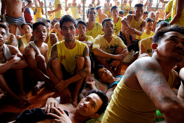 Inmates watch a movie at Quezon City Jail in Manila, Philippines October 19, 2016. (Photo by Damir Sagolj/Reuters)