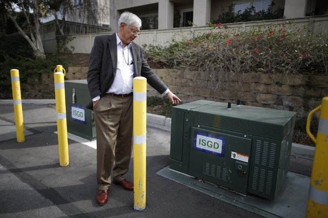 Jerry Thode, sub project manager of the Irvine Smart Grid Demonstration project, points out a community energy storage box in Irvine, California January 26, 2015. (Photo by Lucy Nicholson/Reuters)