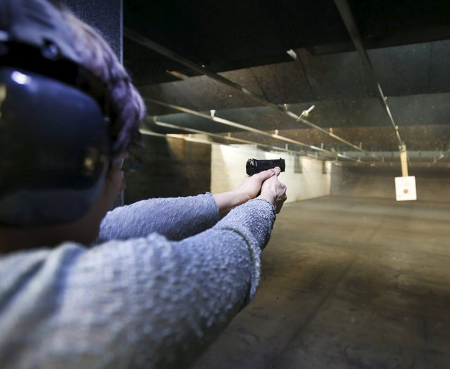 First time gun owner, Jessie Palmieri fires a H&K VP9 9mm at the Ringmasters of Utah gun range, in Springville, Utah on December 18, 2015. (Photo by George Frey/Reuters)