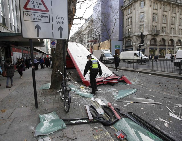 Emergency services work at the scene of a bus accident on the Kingsway in central London February 2, 2015. (Photo by Peter Nicholls/Reuters)