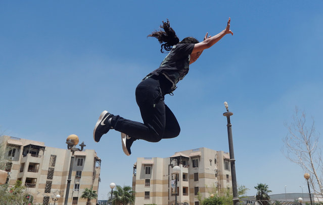 """Mariam Emad from Parkour Egypt """"PKE"""" practices her parkour skills around buildings on the outskirts of Cairo, Egypt on July 20, 2018. (Photo by Amr Abdallah Dalsh/Reuters)"""