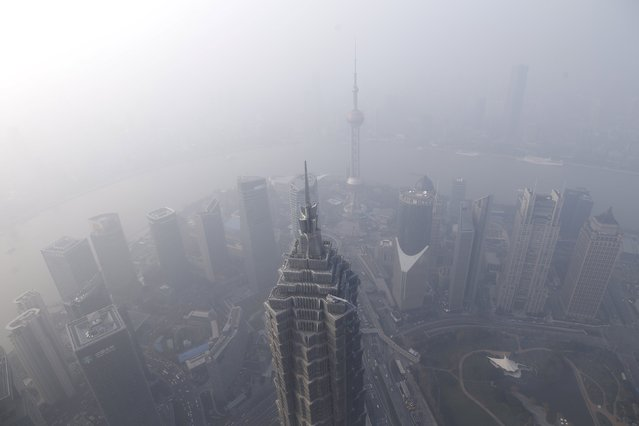 A general view of Shanghai's financial district of Pudong as seen from the Shanghai World Financial Center amid heavy smog in Shanghai, China, December 25, 2015. (Photo by Aly Song/Reuters)