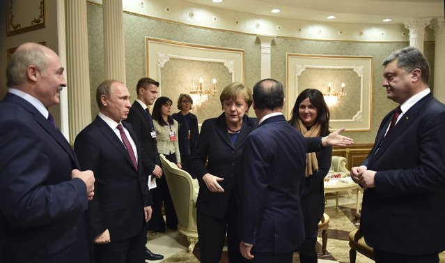 Russia's President Vladimir Putin (2nd L), Ukraine's President Petro Poroshenko (R), Germany's Chancellor Angela Merkel (4th R) and France's President Francois Hollande (3rd R) attend a meeting on resolving the Ukrainian crisis, with Belarus' President Alexander Lukashenko (L) seen nearby, in Minsk, February 11, 2015. (Photo by Mykola Lazarenko/Reuters)