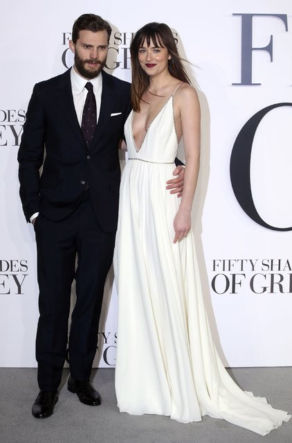 """Actors Jamie Dornan (L) and Dakota Johnson arrive for the British premiere of """"Fifty Shades of Grey"""" in London February 12, 2015. (Photo by Paul Hackett/Reuters)"""