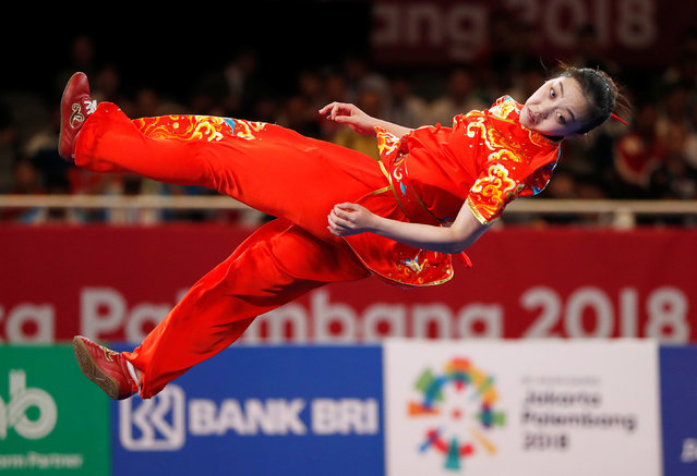 Qi Xinyi of China competes in the changquan event at the women' s wushu competition during the 2018 Asian Games in Jakarta on August 22, 2018. (Photo by Issei Kato/Reuters)