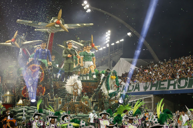 Dancers from the Mancha Verde samba school perform on a float during the Carnival parade at the Sambodromo in Sao Paulo, Brazil, Friday, February 13, 2015. (Photo by Andre Penner/AP Photo)