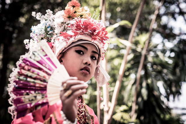 Initiates wear elaborate floral crowns and fine tunics during the three day ceremony in Mae Hong Son, Thailand, April 2016. (Photo by Claudio Sieber/Barcroft Images)