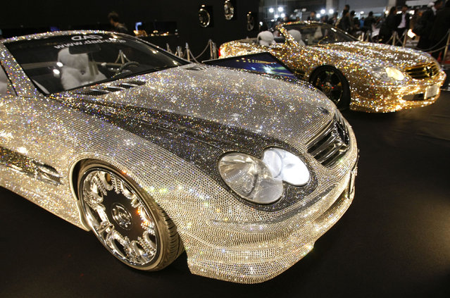 Customized Mercedes-Benz SL600s, Luxury Crystal Benz, studded with 300,000 Swarovski crystal glass, are displayed at the pavilion of custom car accessory company Garson/D.A.D at Tokyo Auto Salon 2010 at Makuhari Messe in Chiba, east of Tokyo, January 15, 2010. (Photo by Toru Hanai/Reuters)