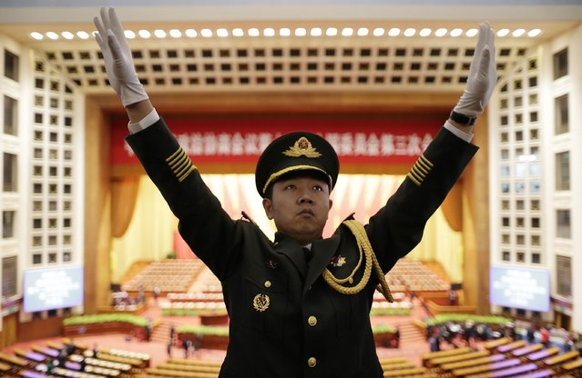 A military band conductor practices during rehearsal ahead of the opening session of Chinese People's Political Consultative Conference (CPPCC) at the Great Hall of the People in Beijing, March 3, 2015. REUTERS/Jason Lee