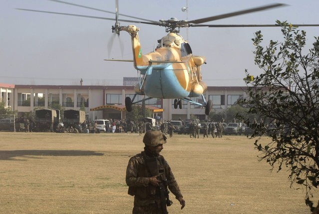 A Pakistani army helicopter lands in Bacha Khan University in Charsadda town, some 35 kilometers (21 miles) outside the city of Peshawar, Pakistan, Wednesday, January 20, 2016. Gunmen stormed Bacha Khan University named after the founder of an anti-Taliban political party in the country's northwest Wednesday, killing many people, officials said. (Photo by Mohammad Sajjad/AP Photo)