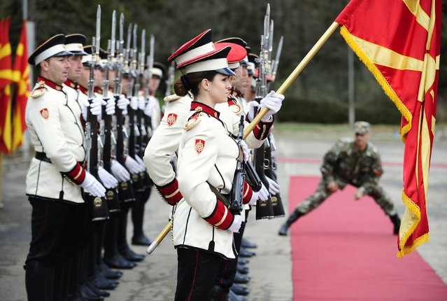 Corporals Drakana Kitanovska (front) and Verica Zlatevska (obscured) attend an honour guard training session at an army barracks in Skopje March 4, 2015. Macedonia's honour army battalion, the ceremonial uniformed guard that receives every foreign president, dignitaries and delegations, but also sees off and welcomes the head of state every time he leaves the country, has a different glow. For the first time in the history of Macedonia's army, the honour guard has two women in its ranks. There has not been an event in which one of them is not in the first row. Zlatevska joined the army in 2003, Kitanovska in 2006. Picture taken March 4, 2015.  REUTERS/Ognen Teofilovski (MACEDONIA - Tags: MILITARY SOCIETY)