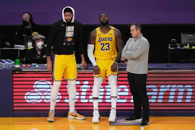Los Angeles Lakers forward Anthony Davis (3), forward LeBron James (23) and coach Frank Vogel react in the second half during game six of their first round NBA Playoffs against the Phoenix Suns on Thursday, June 3, 2021, in Los Angeles. (Photo by Kirby Lee/USA TODAY Sports)