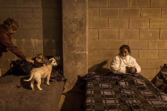 Locals rest in a shelter during a forest fire in the hills of the port city of Valparaiso, March 14, 2015. (Photo by Pablo Sanhueza/Reuters)