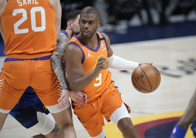 Phoenix Suns guard Chris Paul drives as Denver Nuggets guard Facundo Campazzo is slowed by screen by Suns forward Dario Saric during the first half of Game 3 of an NBA second-round playoff series Friday, June 11, 2021, in Denver. (Photo by David Zalubowski/AP Photo)