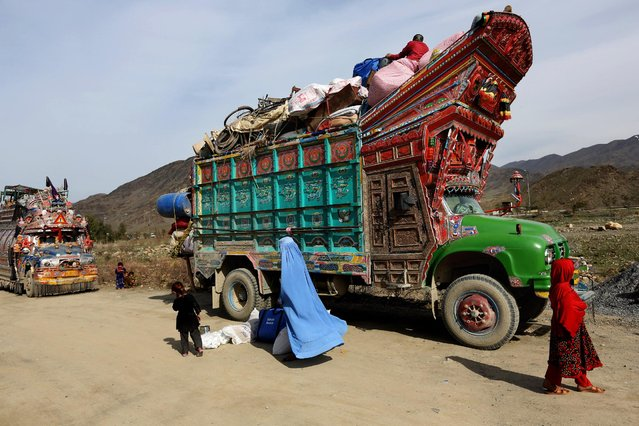 In Wednesday, March 11, 2015 photo, an Afghan refugee family return to Afghanistan through Pakistan's border crossing, Torkham, east of Kabul, Afghanistan. Since January, almost 50,000 Afghan families have passed through Torkham, double the amount of all refugees returning through the border town in 2014, according to the International Organization for Migration. (Photo by Rahmat Gul/AP Photo)