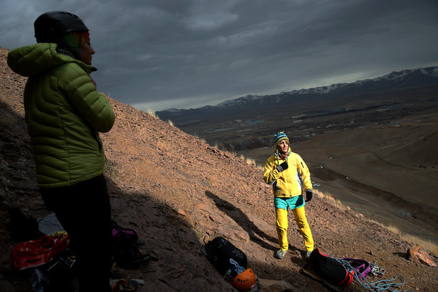 In this Tuesday, January 19, 2016 photo, Iranian rock climber, Farnaz Esmaeilzadeh, right, prepares to start training in a mountainous area outside the city of Zanjan, some 330 kilometers (207 miles) west of the capital Tehran, Iran. (Photo by Ebrahim Noroozi/AP Photo)