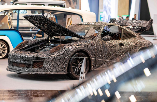 A Porsche 911 GT3 RS assembled out of scrap metal parts is on display at the Tuning Fair auto show in Essen, Germany on November 30, 2018. (Photo by Marcel Kusch/AFP Photo)