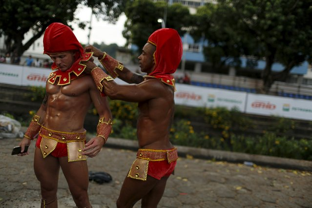 Revellers get ready before the first night of the Carnival parade of samba schools in Rio de Janeiro's Sambadrome February 7, 2016. (Photo by Pilar Olivares/Reuters)