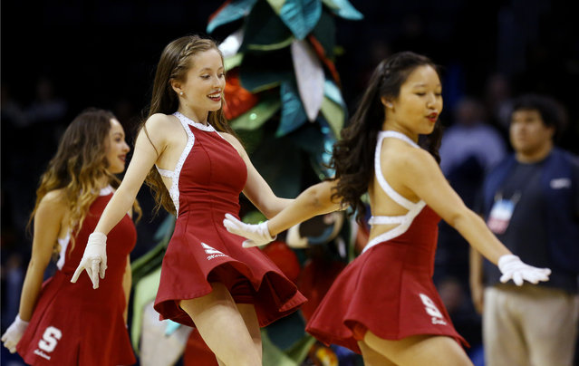 Stanford cheerleaders perform during a women's college basketball regional semifinal game against Notre Dame in the NCAA Tournament, Friday, March 27, 2015, in Oklahoma City. (Photo by Sue Ogrocki/AP Photo)