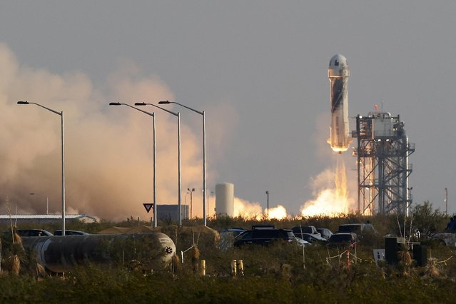 Billionaire businessman Jeff Bezos is launched with three crew members aboard a New Shepard rocket on the world's first unpiloted suborbital flight from Blue Origin's Launch Site 1 near Van Horn, Texas , U.S., July 20, 2021. (Photo by Joe Skipper/Reuters)