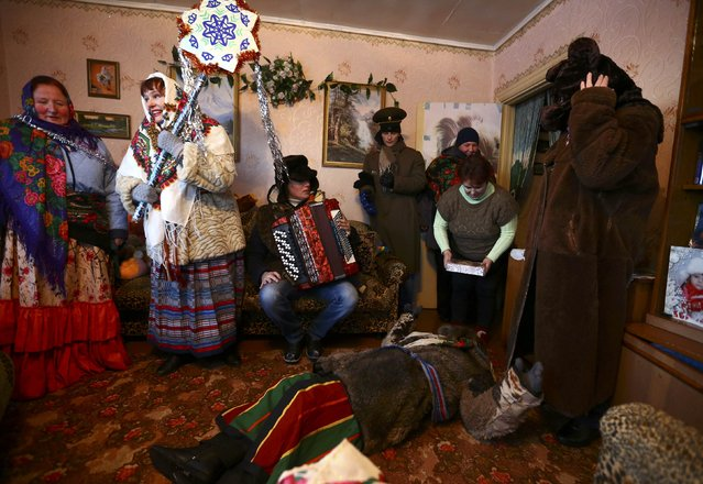 "People celebrate the pagan rite called ""Kolyadki"", a pagan winter holiday which over the centuries has merged with Orthodox Christmas celebrations in some parts of Belarus, in the village of Skirmantava, Belarus January 7, 2017. (Photo by Vasily Fedosenko/Reuters)"