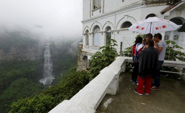 Tourists are seen visiting the Tequendama Falls (Salto del Tequendama) near Bogota March 21, 2015. (Photo by John Vizcaino/Reuters)