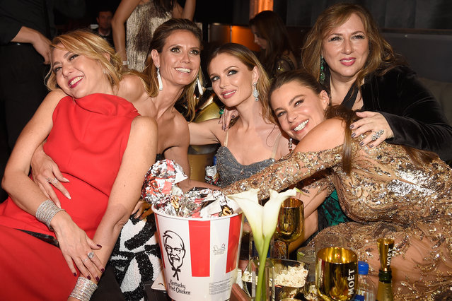 TV personality Heidi Klum, designer Georgina Chapman and actress Sofia Vergara pose with guests at The Weinstein Company and Netflix Golden Globe Party, presented with FIJI Water, Grey Goose Vodka, Lindt Chocolate, and Moroccanoil at The Beverly Hilton Hotel on January 8, 2017 in Beverly Hills, California. (Photo by Kevin Mazur/Getty Images for The Weinstein Company)