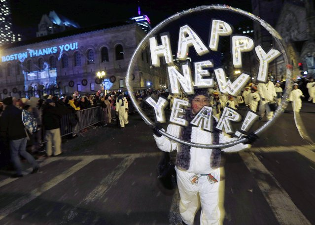 Marchers make their way down Boylston Street during a parade as part of New Year's Eve celebrations in Boston, Tuesday, December 31, 2013. (Photo by Michael Dwyer/AP Photo)