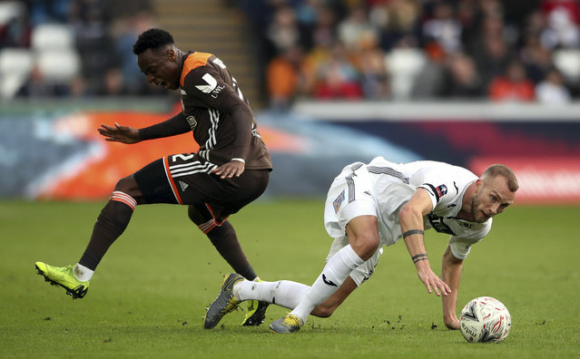 Swansea City's Mike van der Hoorn, right, and Brentford's Moses Odubajo during their English FA Cup fifth round soccer match at the Liberty Stadium in Swansea, England, Sunday February 17, 2019. (Photo by Nick Potts/PA Wire via AP Photo)