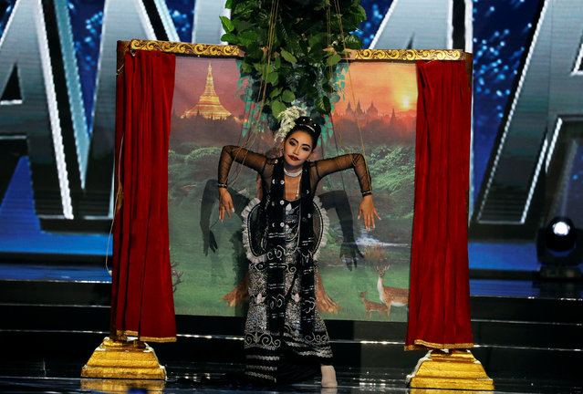 "Miss Universe candidate from Myanmar Htet Htet Htun wears a costume depicting ""Burmese Puppetry"" as she competes during a national costume preliminary competition in Pasay, Metro Manila, Philippines January 26, 2017. (Photo by Erik De Castro/Reuters)"