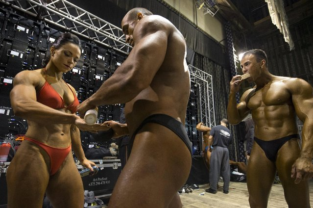 Participants prepare backstage during Belarus bodybuilding and fitness championship in Minsk April 25, 2015. (Photo by Vasily Fedosenko/Reuters)