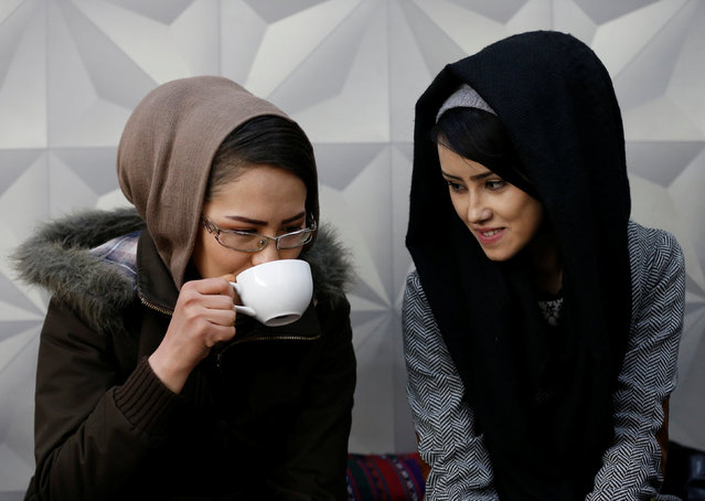 Sima Azimi (L), 20, a trainer and Sabera Bayanne, 20, a student at the Shaolin Wushu club, sit inside a restaurant in Kabul, Afghanistan February 2, 2017. (Photo by Mohammad Ismail/Reuters)