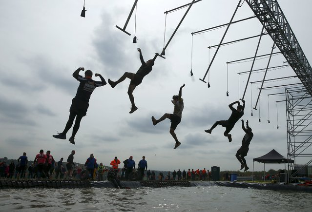 Competitors participate in the Tough Mudder challenge near Henley-on-Thames in southern England May 2, 2015. (Photo by Eddie Keogh/Reuters)