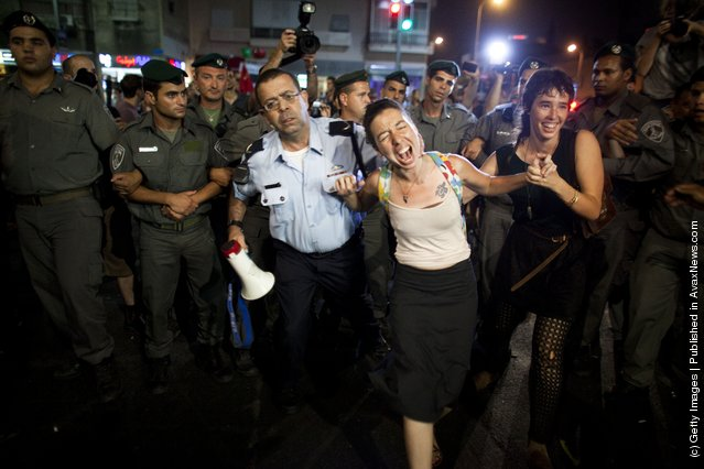 Israeli police officers confront demonstrators as Israelis protest against rising housing prices and social inequalities on July 30, 2011 in Tel Aviv, Israel