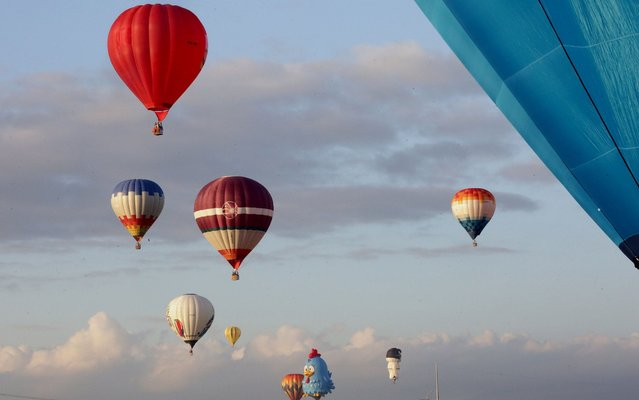 The annual Lubao International Balloon and Music Festival takes place in Pampanga Province, the Philippines, from April 5 to 7, 2019 featuring musical performances, fireworks displays, more than 30 local and international hot air balloons and a wide variety of aerial activities. (Photo by Xinhua News Agency/Shutterstock)
