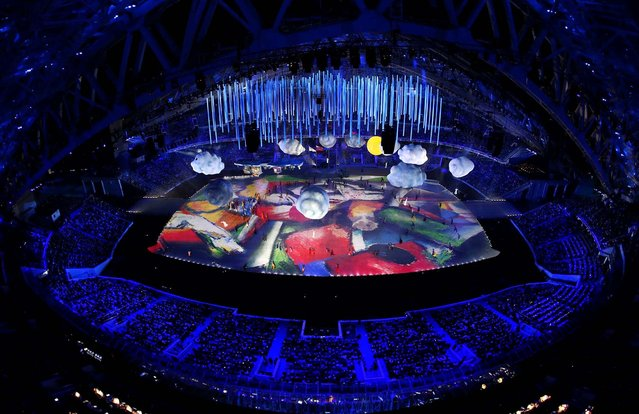 A Marc Chagall painting is projected on stage. (Photo by Matthew Stockman/Getty Images)