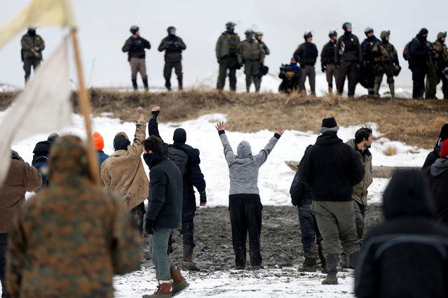 Protesters confront police on the outskirts of the main opposition camp against the Dakota Access oil pipeline near Cannon Ball, North Dakota, U.S., February 23, 2017. (Photo by Terray Sylvester/Reuters)