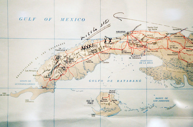 "A map of Cuba annotated by former U.S. President John F. Kennedy, displayed for the first time at the John F. Kennedy Library in Boston, Massachusetts, on July 13, 2005. Former President Kennedy wrote ""Missile Sites"" on the map and marked them with an X when he was first briefed by the CIA on the Cuban Missile Crisis on October 16, 1962. (Photo by Brian Snyder/Reuters)"